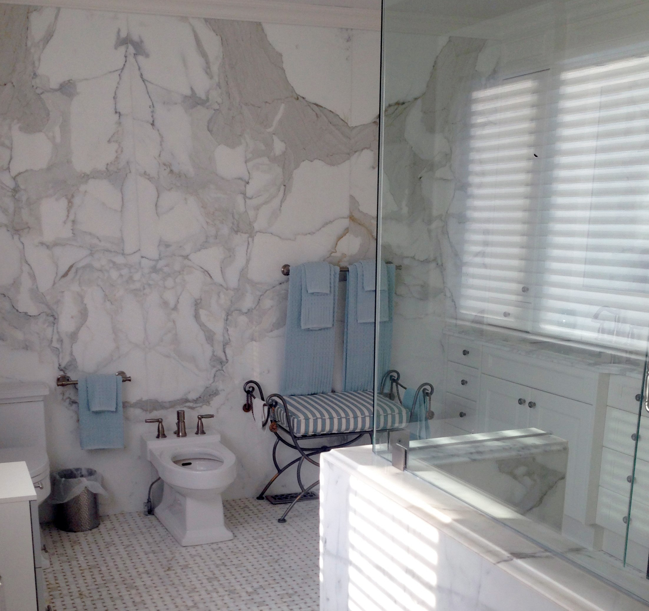 Greco-Roman Style Master Bath Update with Marble Walls marble bathroom design