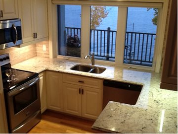 Light Coloured Granite Enlarges The Look of a Small Kitchen