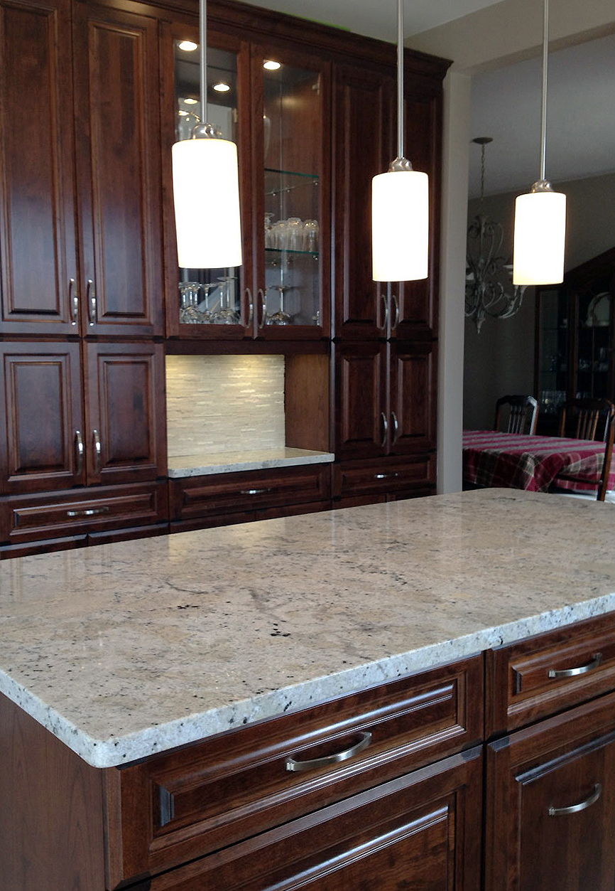 Our Updated Kitchen with a Granite Countertop Highlight.